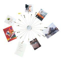 Rundes Mobile SUNBURST mit 24 Klammern von Kikkerland. Der Fotohalter präsentiert Notizen, Postkarten und ihre Lieblingsbilder.