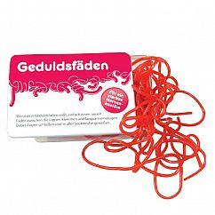 liebeskummerpillen Geduldsfäden: rote Fruchtgummischnüre mit Erdbeergeschmack in kleiner Kunststoffbox.
